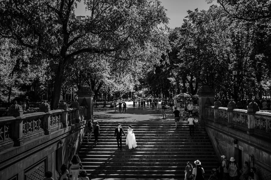 couple walking down the stairs black and white photo