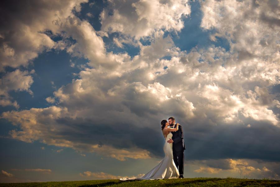 couple portraits cloudy sky