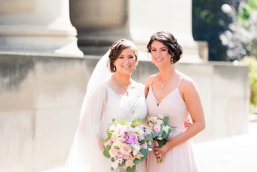 bride and bridesmaid outdoors