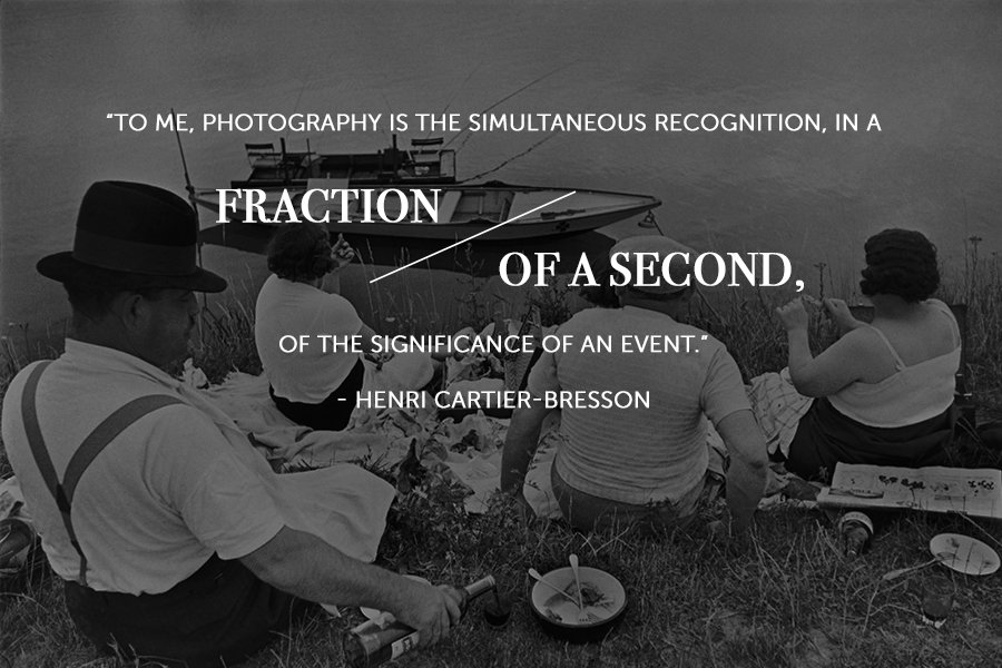 A famous photo quote by Henri Cartier-Bresson over a black and white image four people having a picnic on the grass, facing the water where there is a sail boat.
