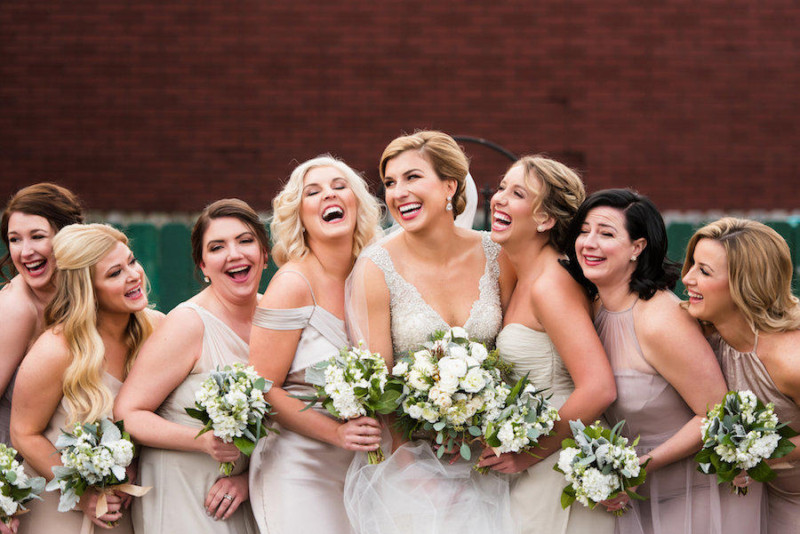 bridal party shot of the bride and bridesmaid laughing