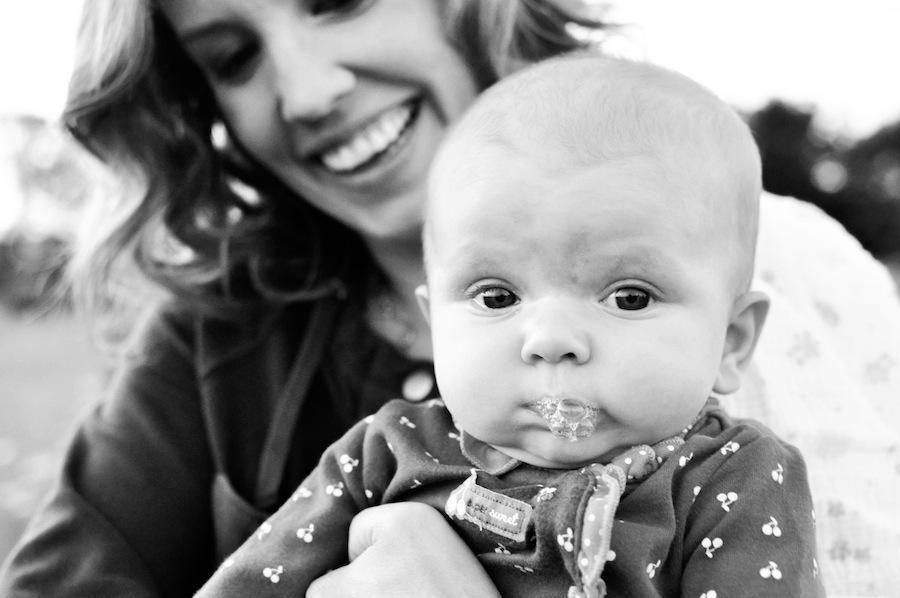 A black and white image of Leeann Marie with her daughter in her arms.