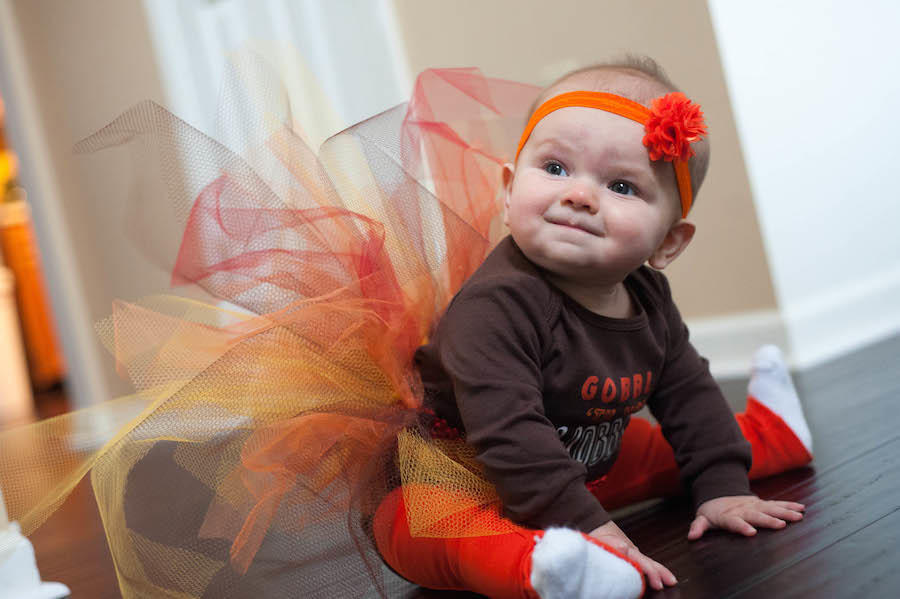 An image by Leeann Marie of her daughter in a Halloween outfit - Balancing baby and business