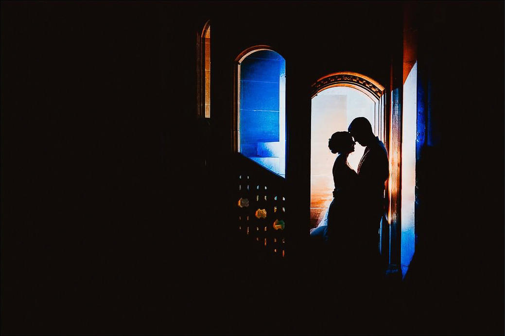 A silhouetted image of a couple by Alistair Jones - a UK wedding photographer