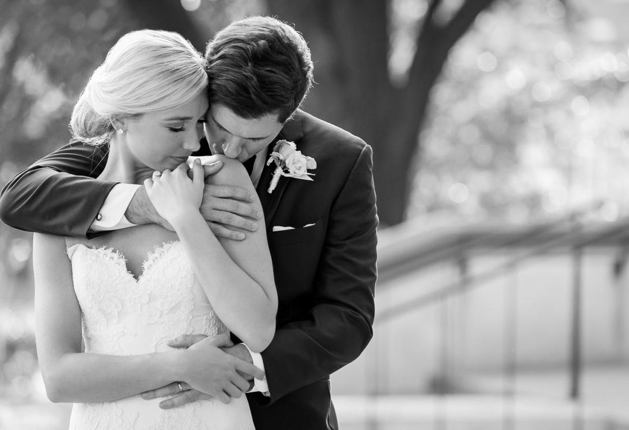A black and white image of a bride and groom