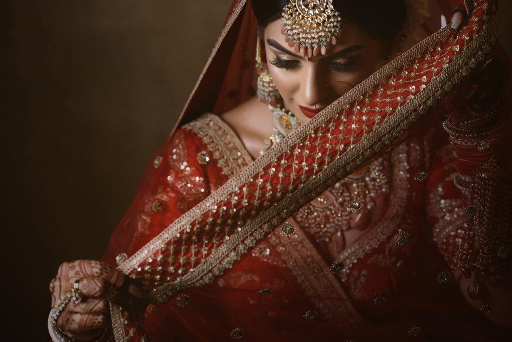 A beautiful portrait shot of a bride in an Indian wedding dress