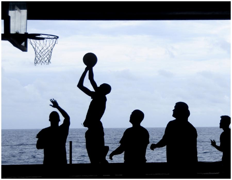 Silhouette of boys playing basketball