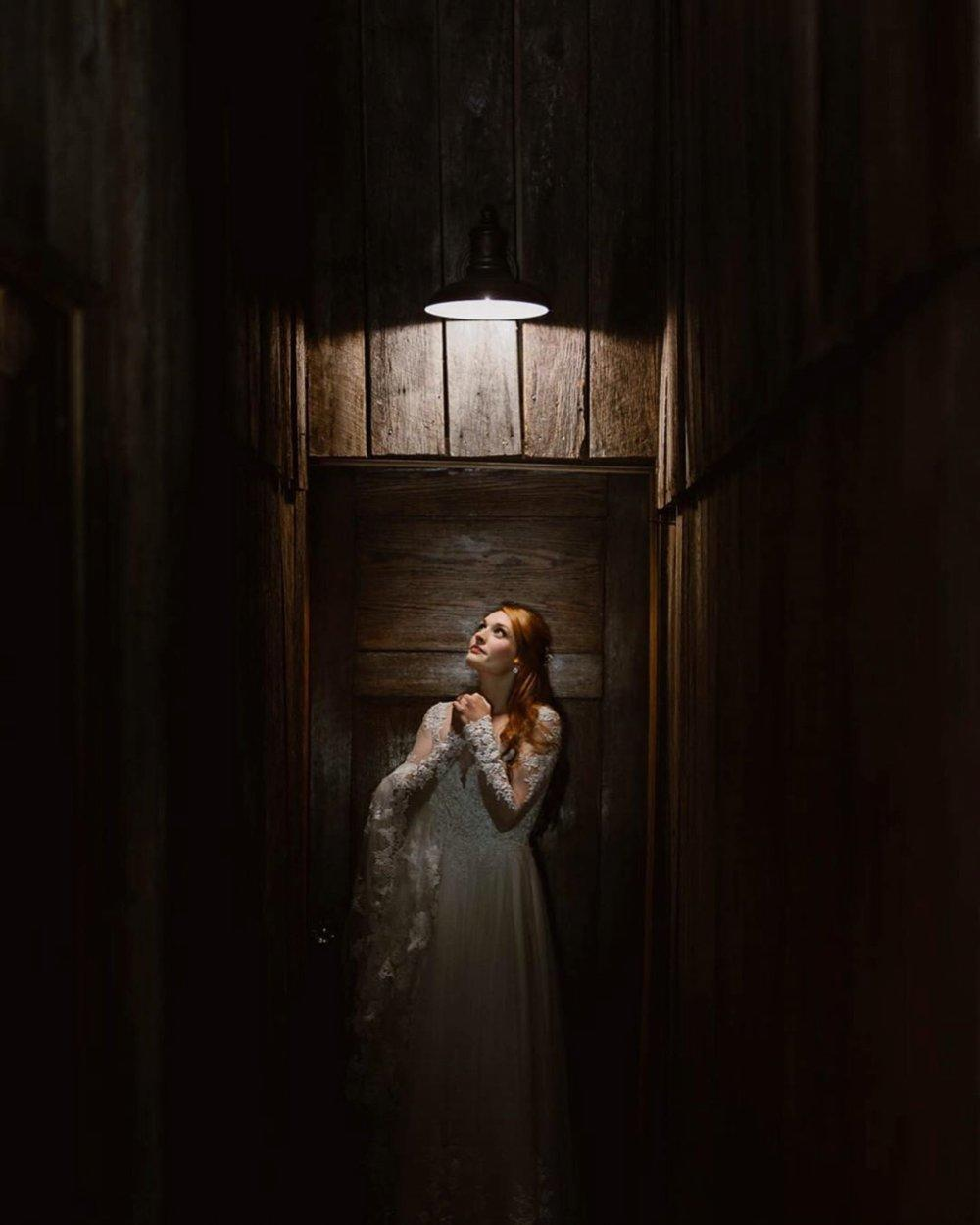 Porchlight beautifully highlighting a bride standing