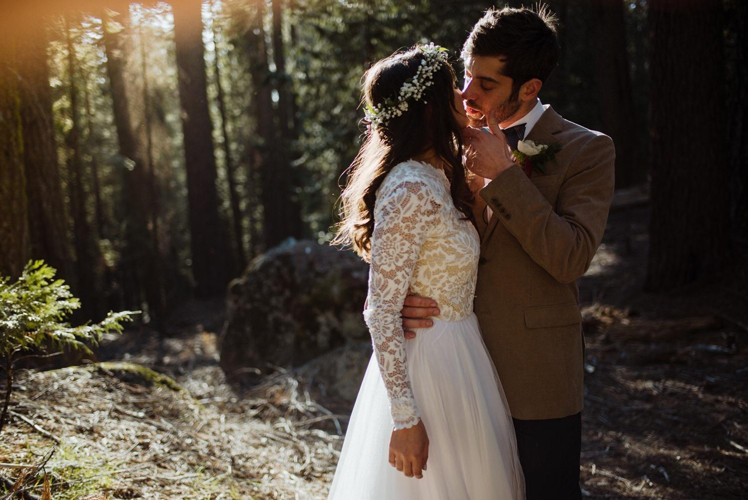 Bride and groom in each other arms in a forest