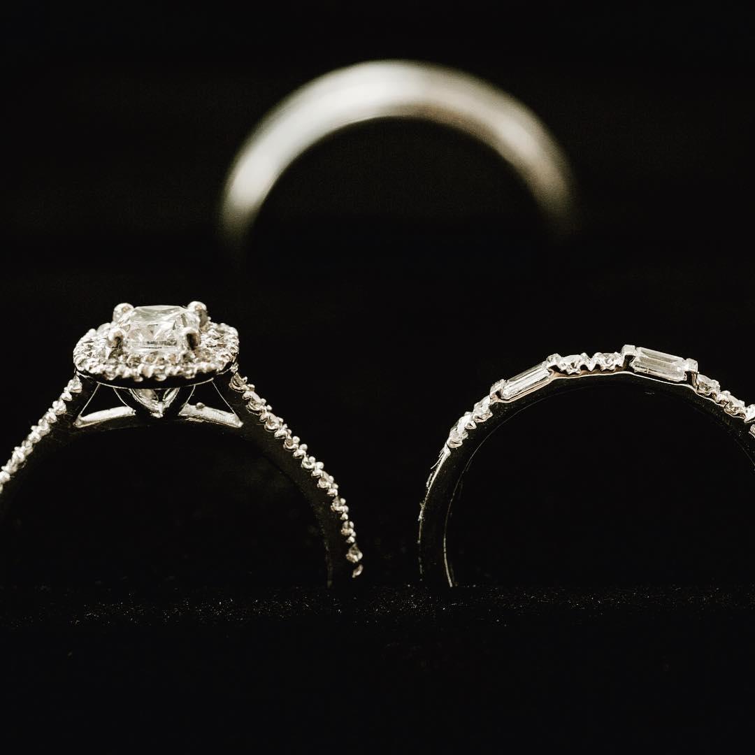 close up photo of wedding rings on black velvet