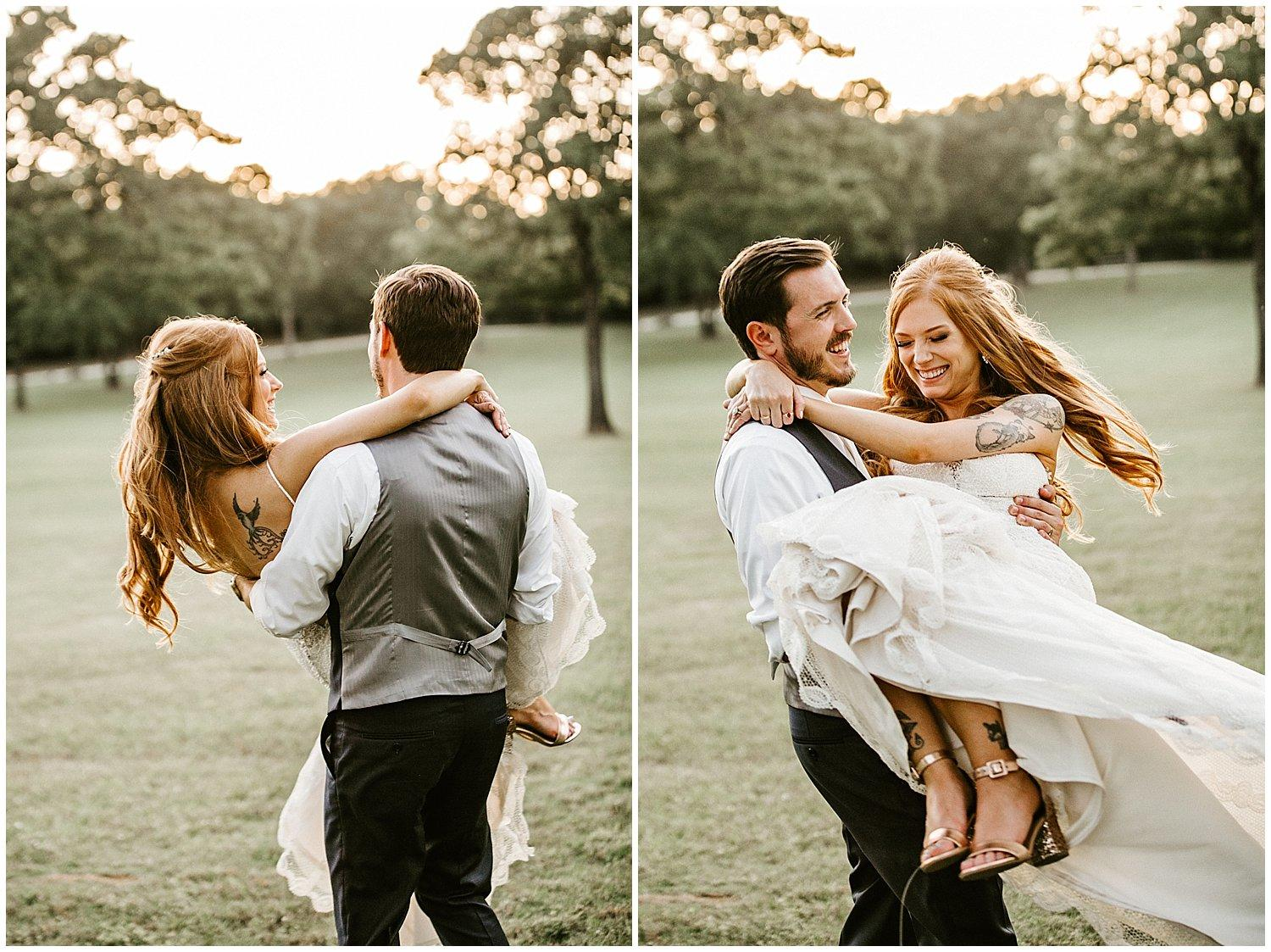 grooms swinging his bride around in his arms on green grass at sunset
