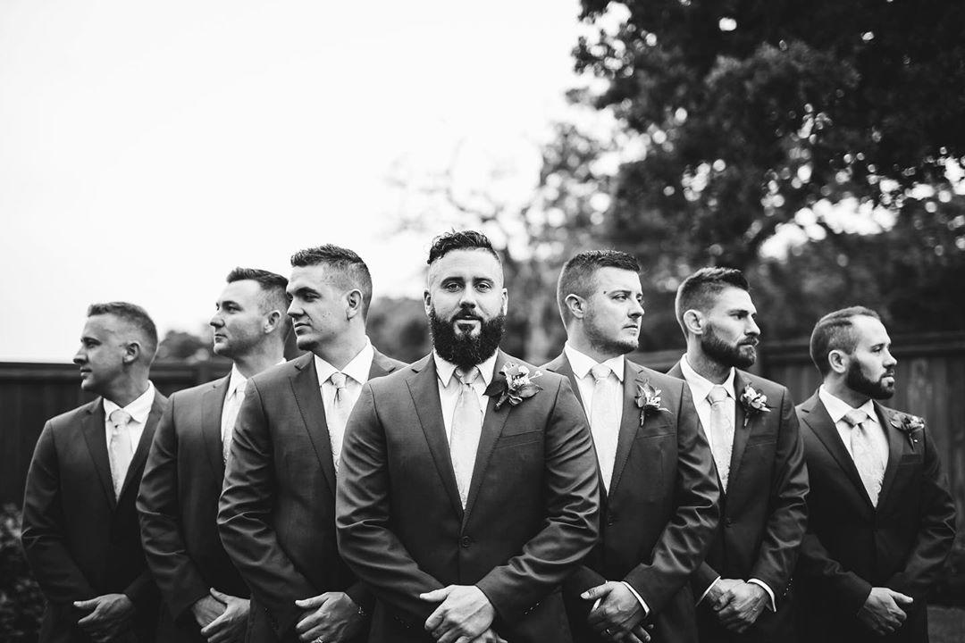black and white photo of groom and groomsmen with serious faces