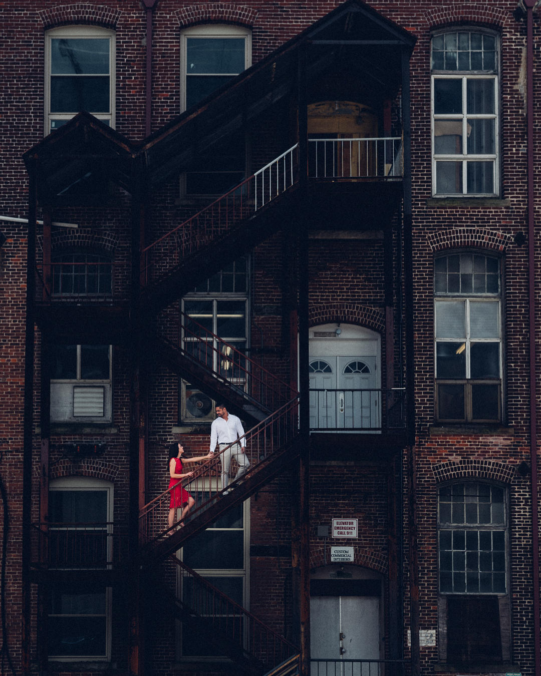 Wonderful engagement shot of a couple on a fire escape.