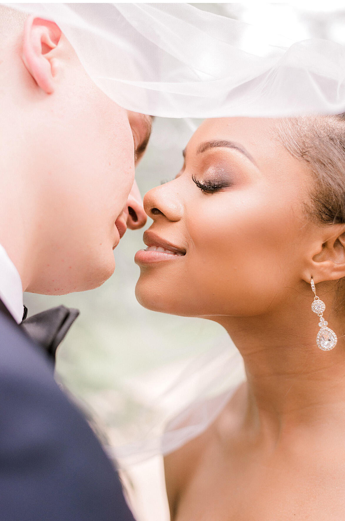 anastasia gentry image of couple kissing close up under veil