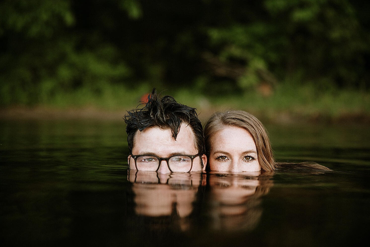 couple in water with reflection