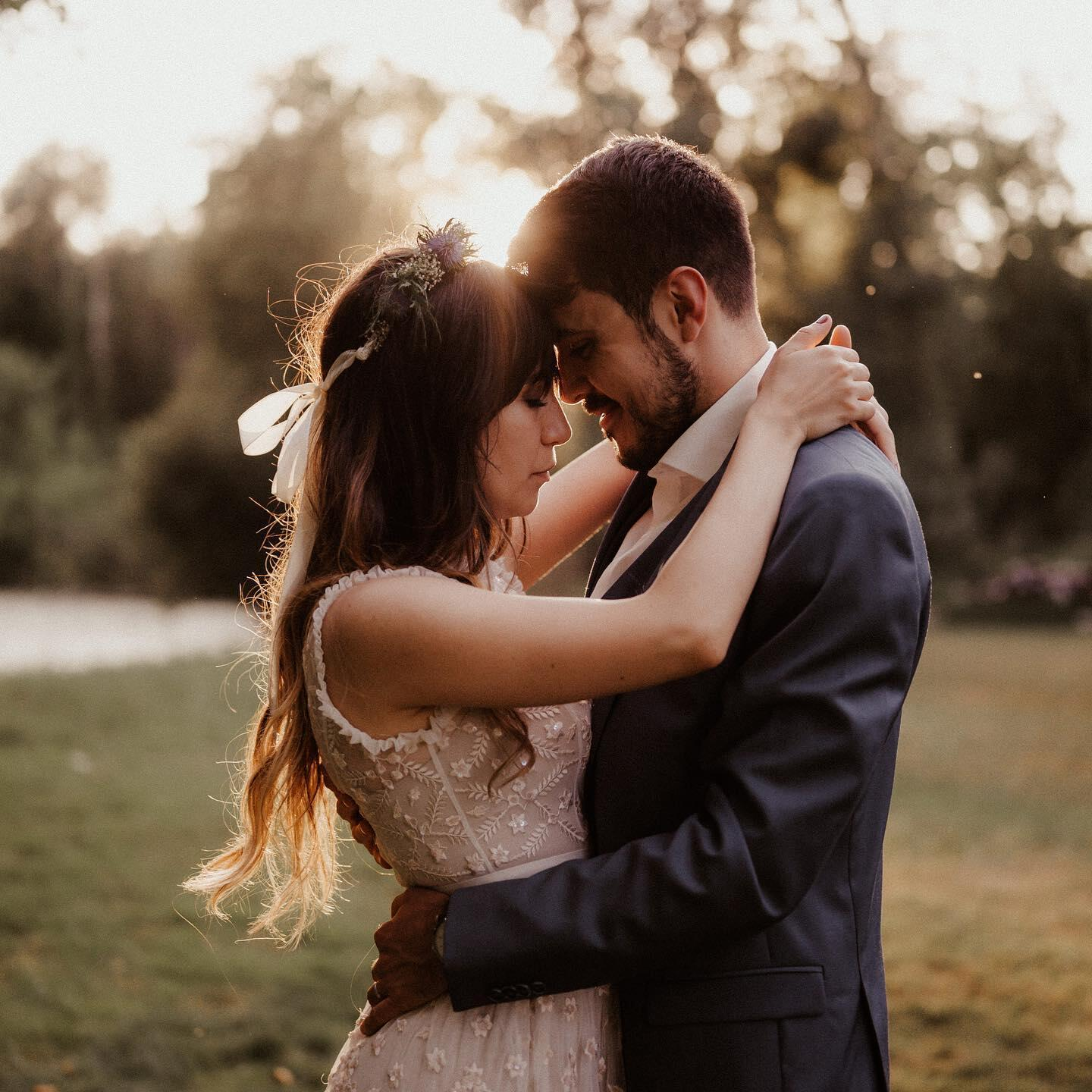 A couple leaning forehead to forehead for their engagement photo shoot.