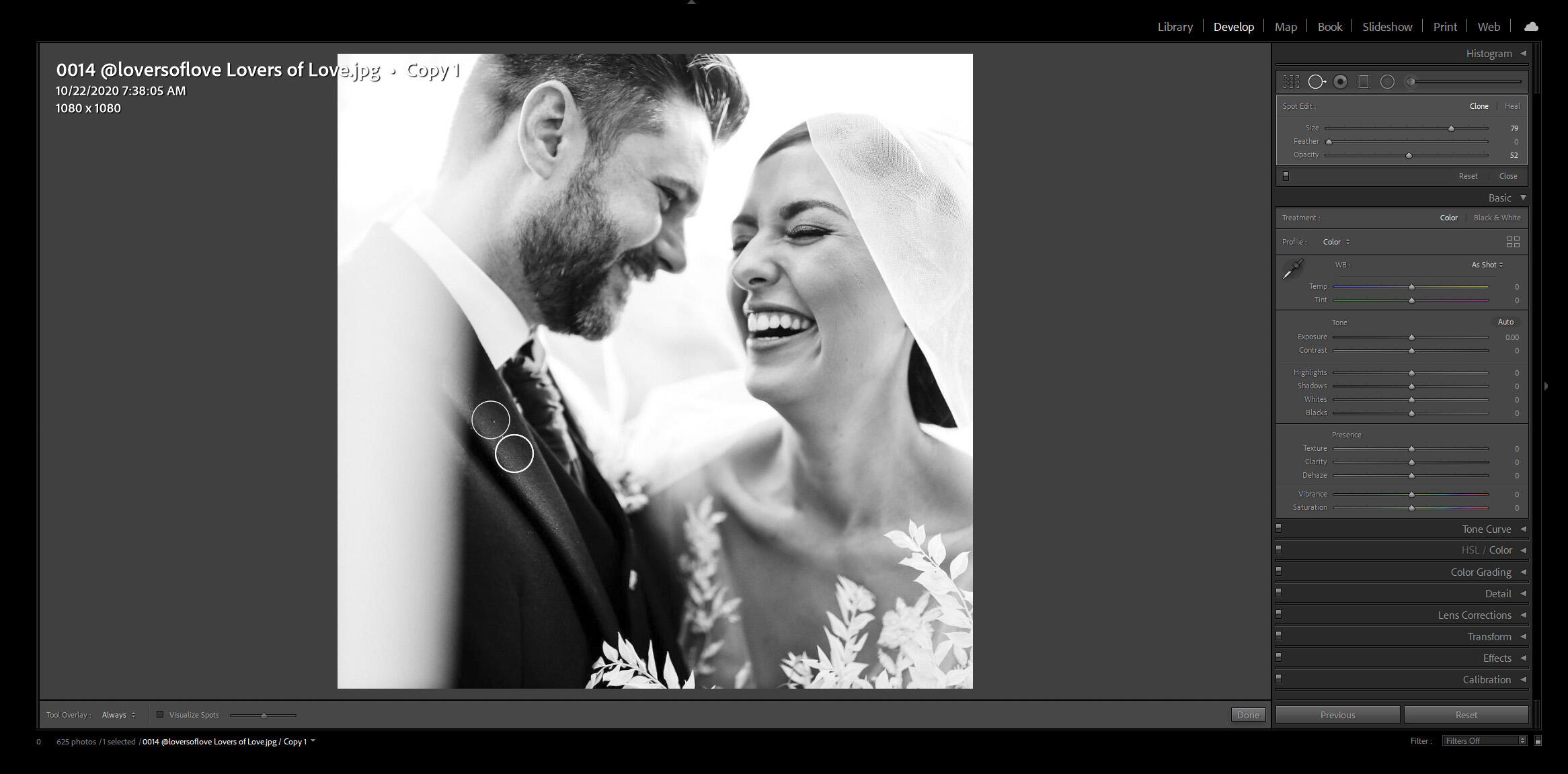 black and white image of groom and bride laughing