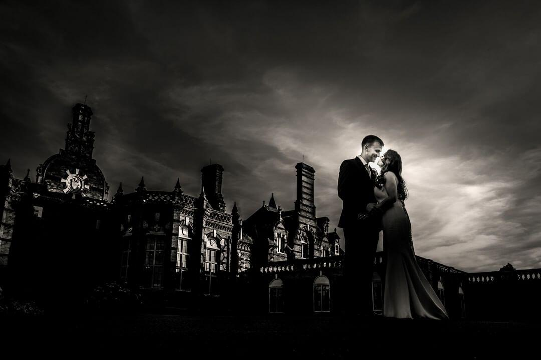 couple with stormy sky in black and white