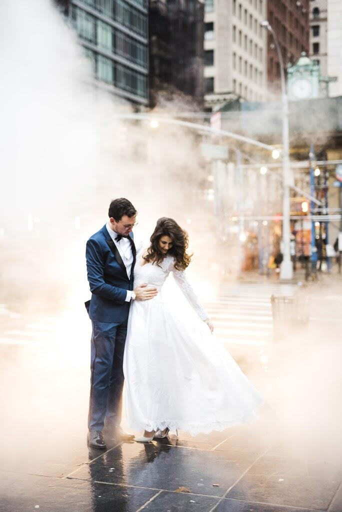 Apollo Fields New York City City Hall Elopement couple standing over subway grate in rain