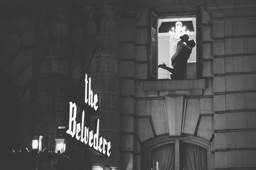 image of couple in window at the belvedere hotel