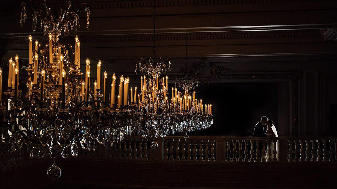 chandelier and couple kissing in silhouette with veil