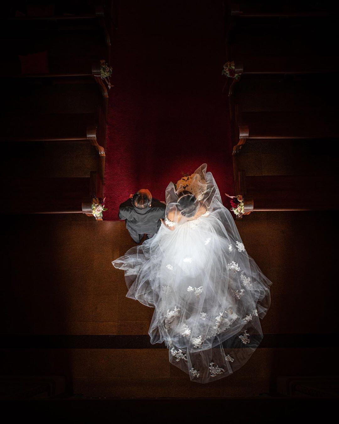 bride and groom walking down aisle viewed from above