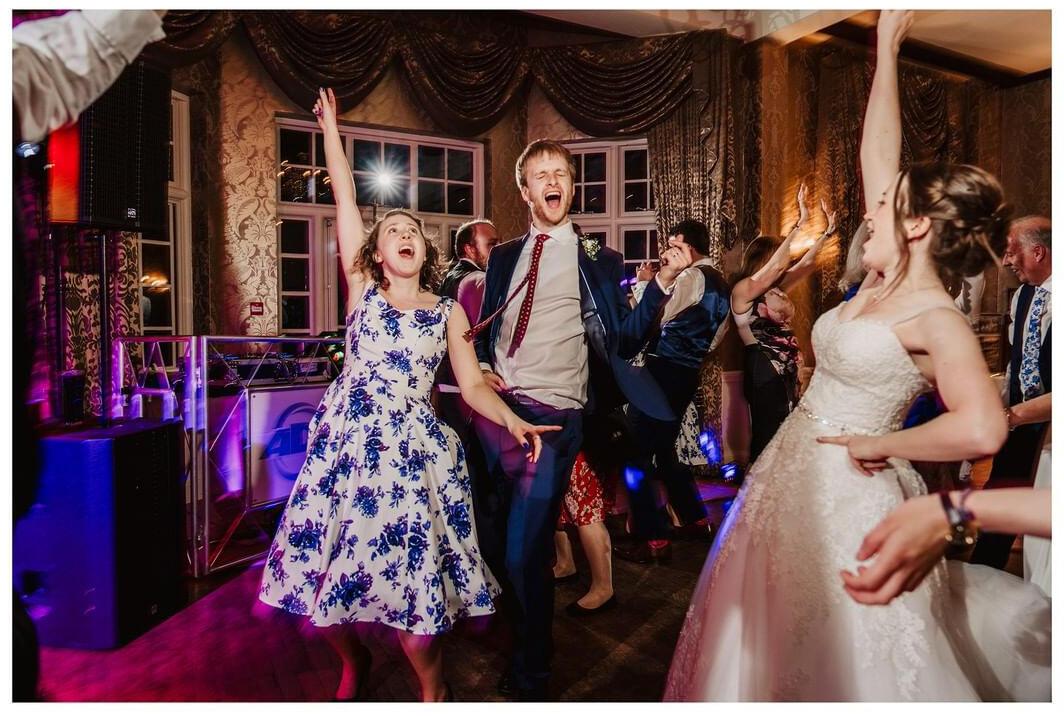 people dancing with bride on dance floor