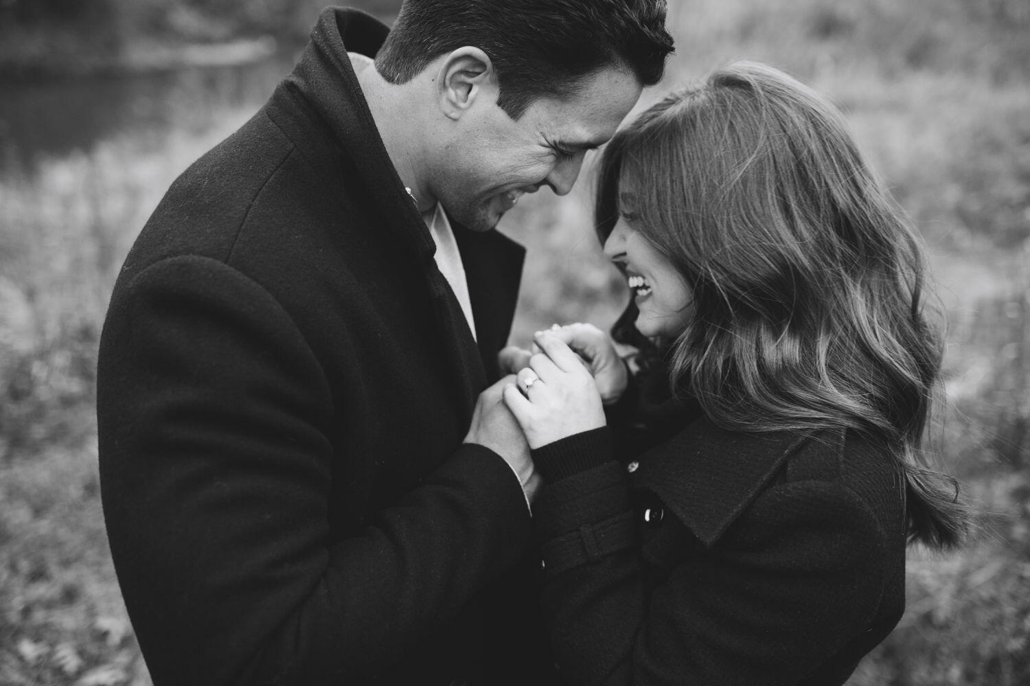 black and white photos of a couple laughing during engagement session
