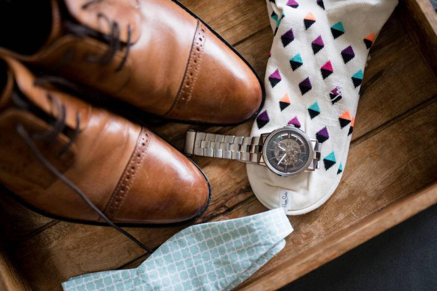 Groom's shoes, socks, watch, and bow tie