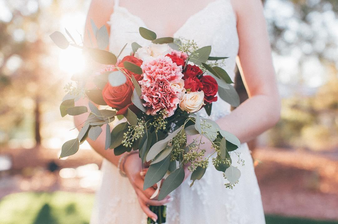 A close-up shot of a bridal bouquet with colorful flowers